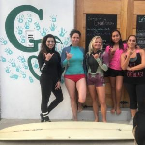 five ladies ready to surf